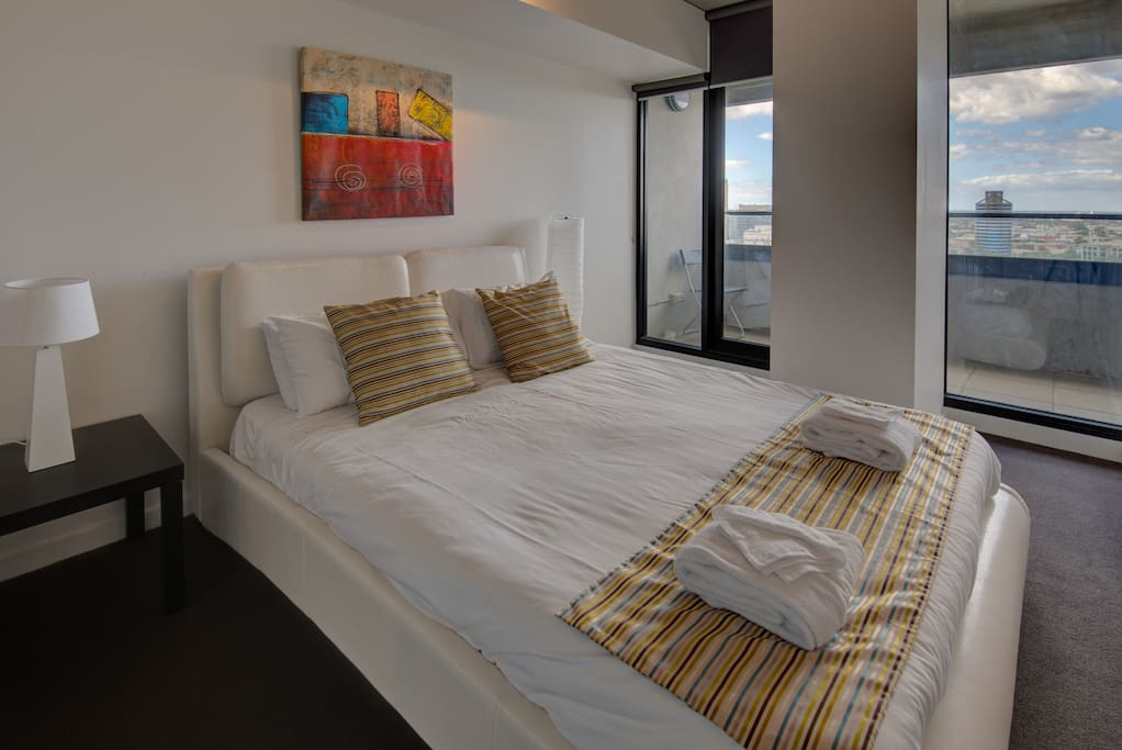 The first bedroom has a queen size bed and ensuite with views over the bay