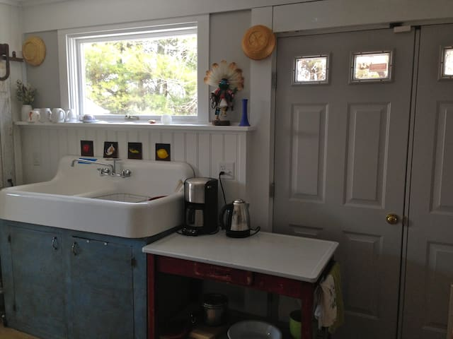 Main Entry door and Kitchen farm sink