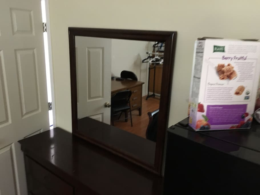 Dresser with attached upright mirror.