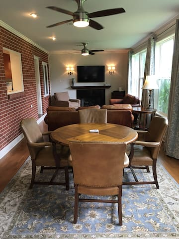 Den 1st Floor 12'x32' Leather sofa, loveseat and TV dinner style table.  Round table and 4 leather chairs.