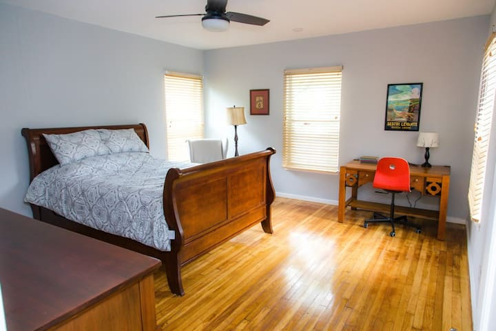 Master bedroom with sleigh bed and work space