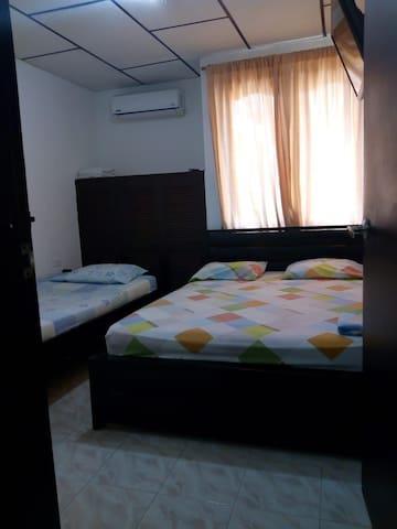 Casa Carolay alcoba privada con baño privado.