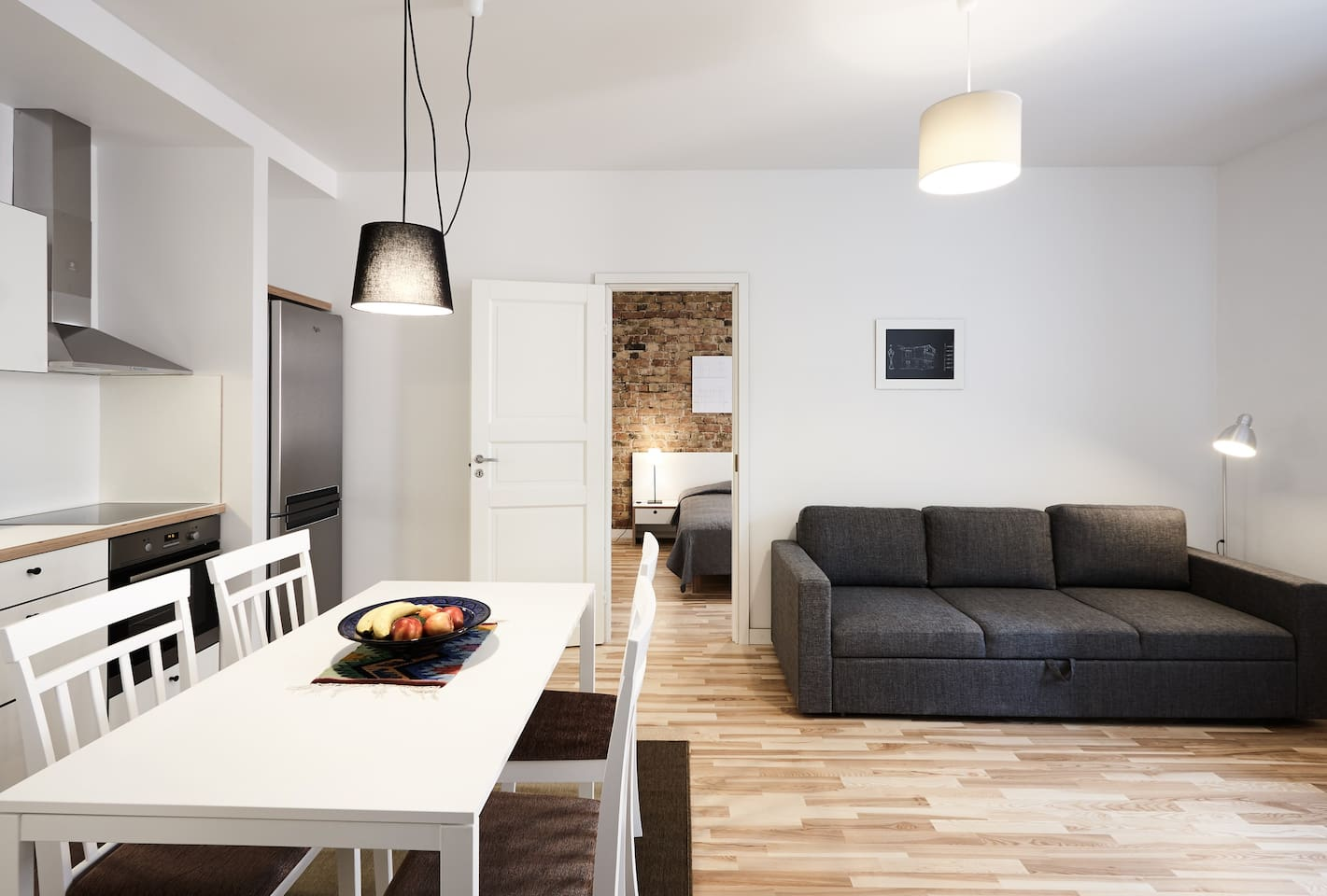 Living room with open space kitchen and sleeper sofa