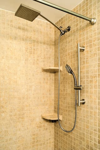 Use the handheld showerhead to rinse off the sand.