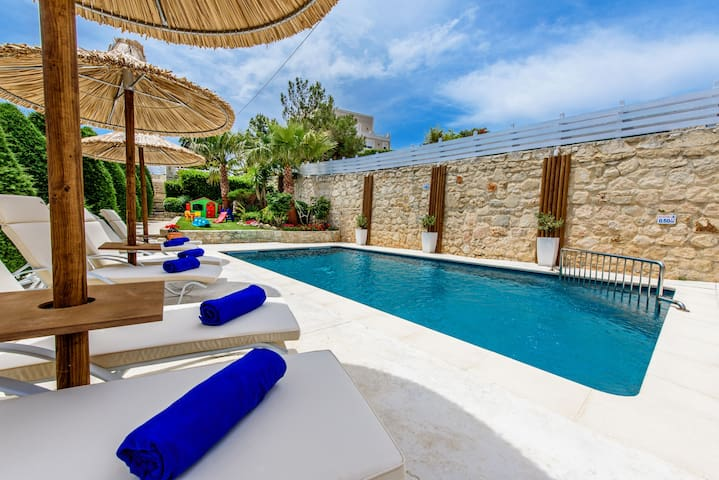 Wonderful sunbathing terrace equipped with sun beds and umbrellas