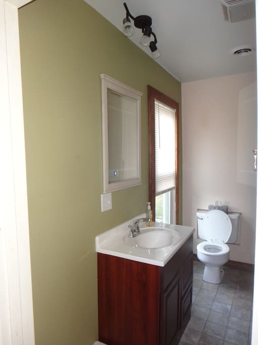 Bathroom with shower.  Towels and linens provided.