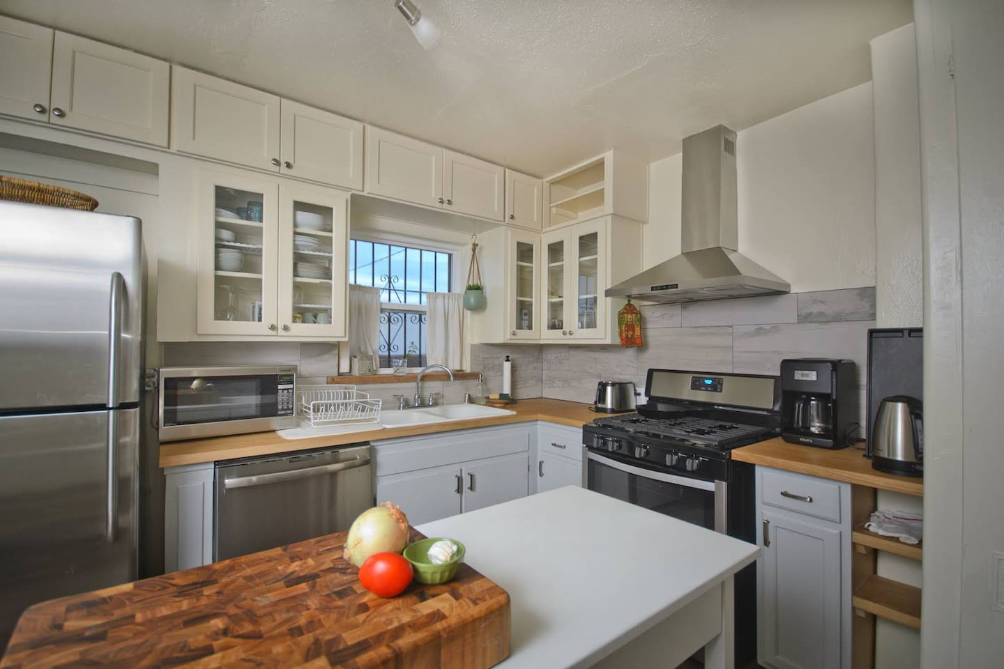 Kitchen with large and small appliances.