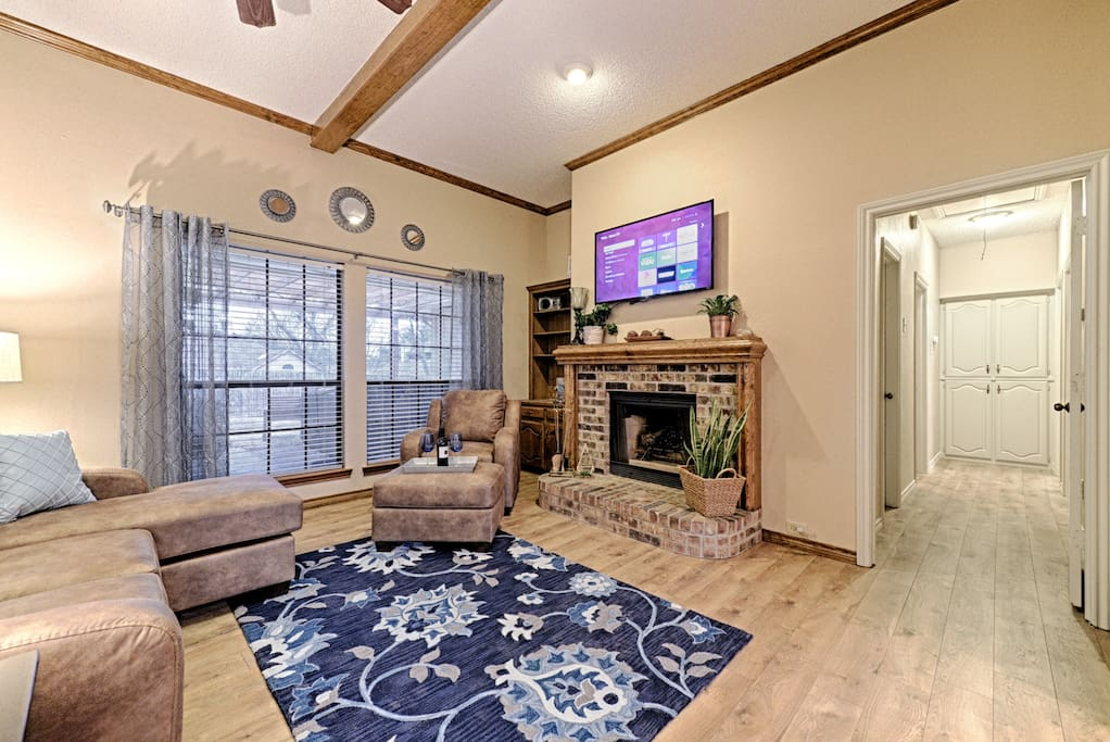 "Spacious living room with 50"" HDTV"