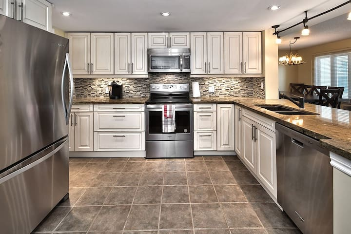 Fully stocked kitchen has upgraded cabinetry, stainless steel appliances and granite countertops