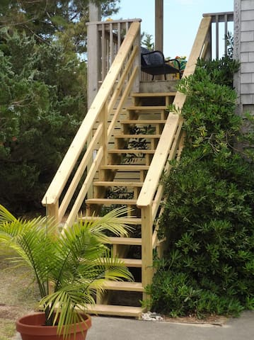 New front stairs leading to a nice size, partially covered deck.