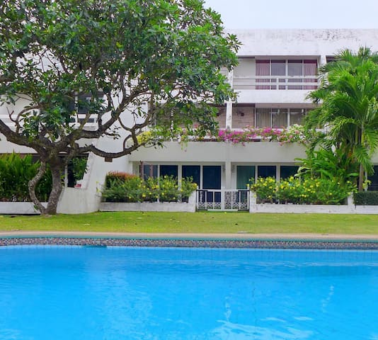 Ground Floor Beachfront Condo with garden and pool