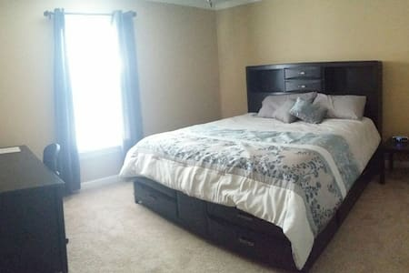 King size bed, office space, & full bath - Cary
