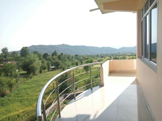 Green valley family suite room at Bir Billing