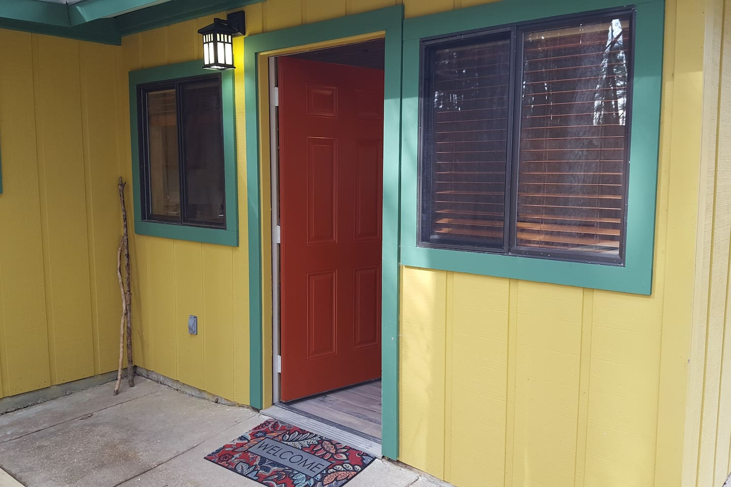 WELCOME - Vintage colors and craftsman charm welcome our guests.  A large crock out front holds cane walking sticks and wiener roasting sticks for your use.