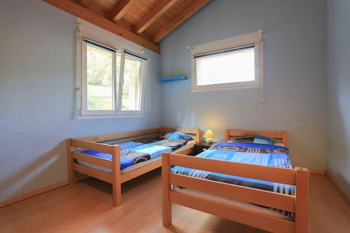 Chambre 2 lits dans villa spacieuse
