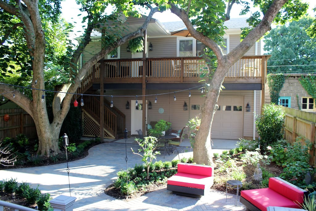 View of our Carriage House showing access stairs, deck and garage underneath