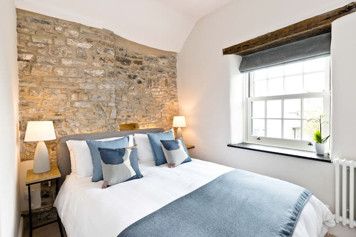 Bedroom 1 - Fixed Double - Feature Stone Wall and Wardrobe 2