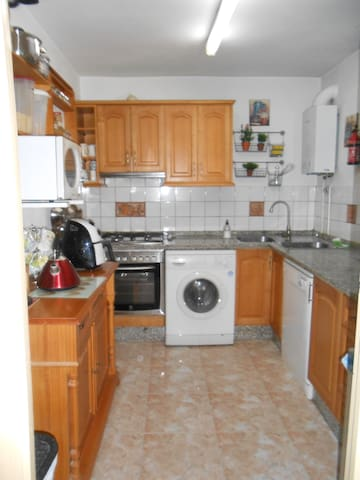 Fully equipped kitchen with dishwasher, full size fridge/freezer, oven, hob, air fryer, toaster, kettle, microwave, ice-cream maker, coffee machine, full complement of saucepans and crockery for the guests who enjoy cooking at home.