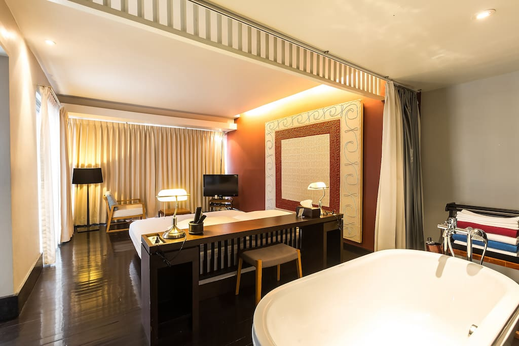 Spacious space and a bathtub in the 1st  suite.