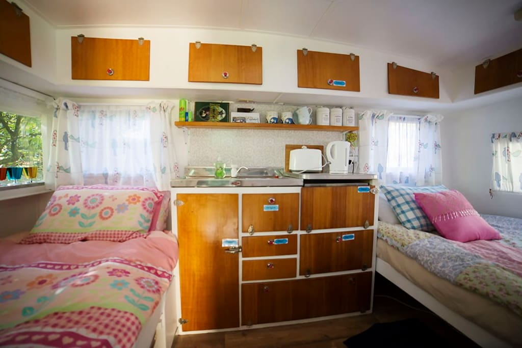 Our cosy wee vintage caravan. A fun and quirky place to stay. Heated and snug. This image shows both beds made up.