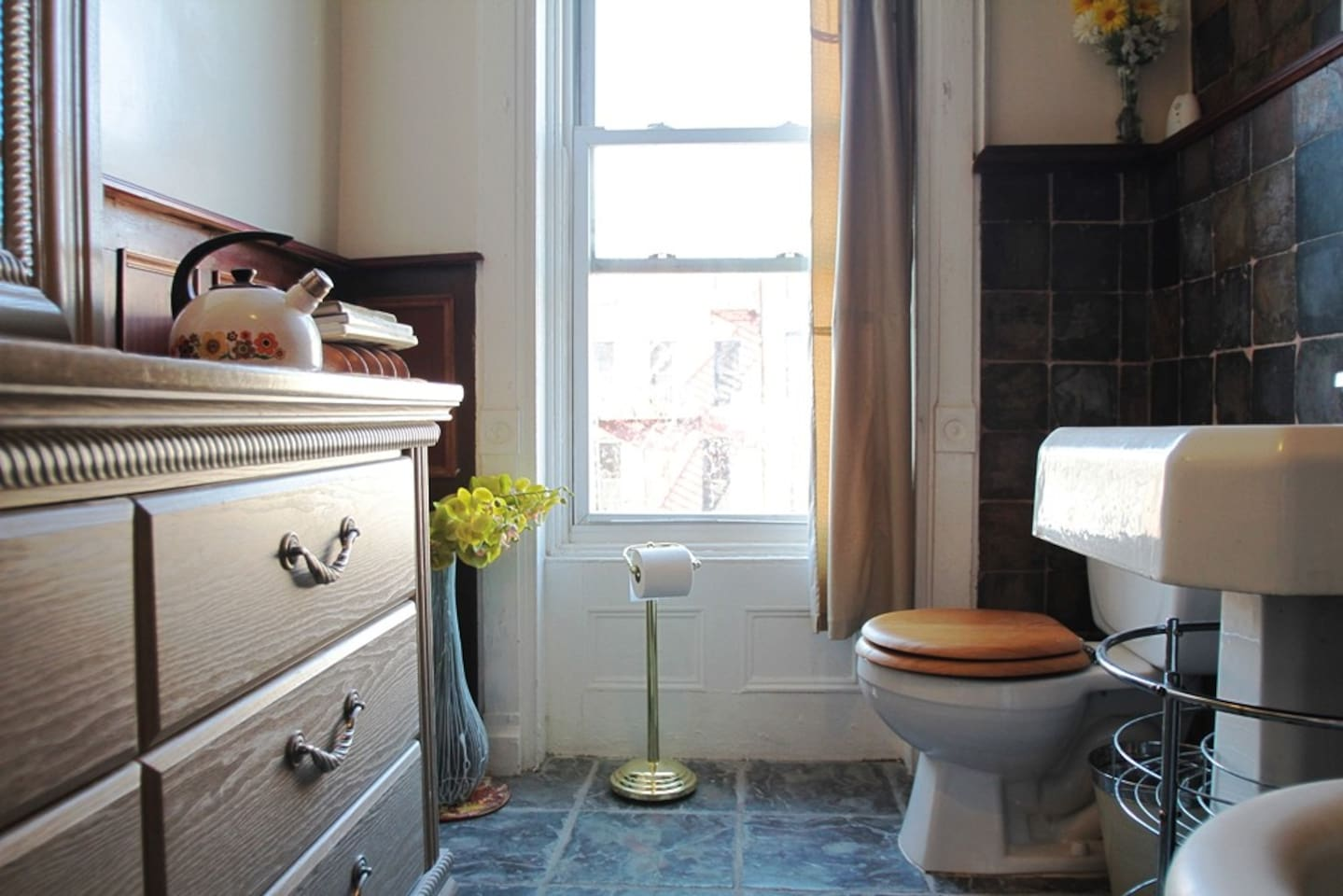 The private bathroom has an entrance next to the front door of the apartment and overlooks the backyard at the north end of Suite Madison.