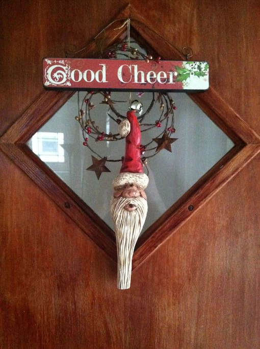The front door decorated for Christmas.