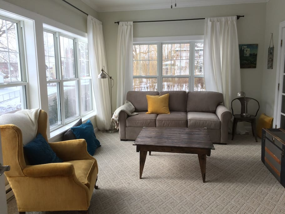 Sunroom with television and pull out couch