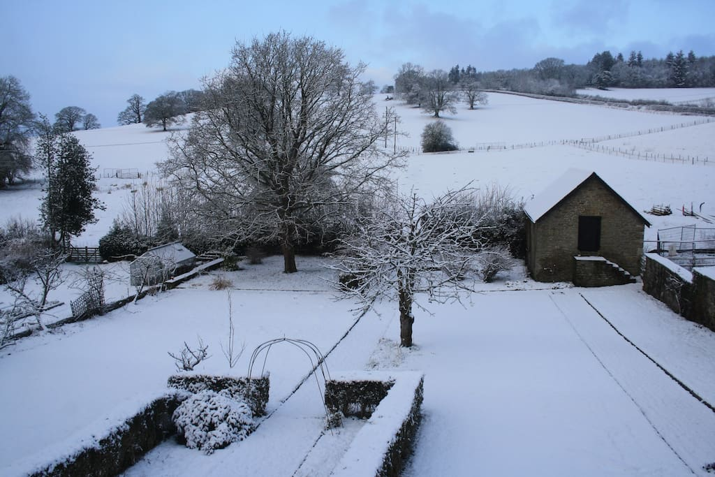 The rear view of the house in the snow! Lots of slopes for sledging.