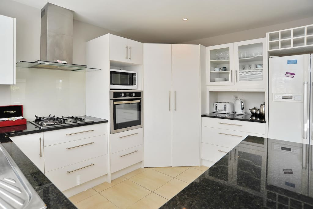 Large modern kitchen with gas hob, wall oven and large pantry