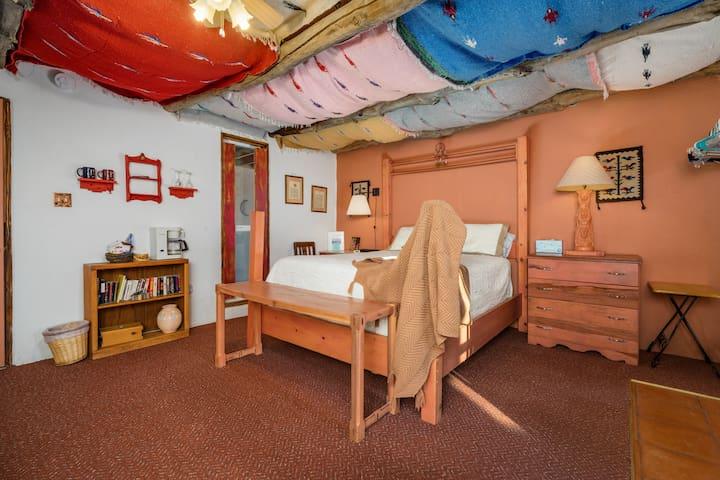 Comfy queen bed, desk area.  Room also has a double futon.