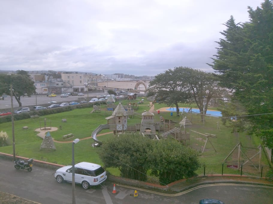 View from bedroom window overlooking water park, beach promenade and Grand Pier