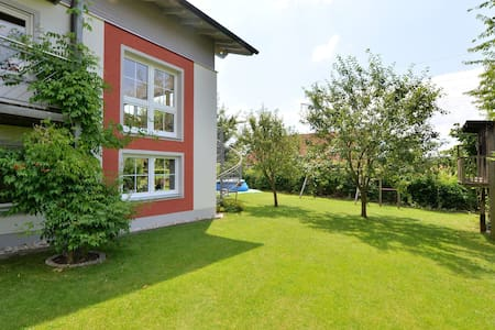 Nice flat with sauna, covered terrace, garden and tree house for children