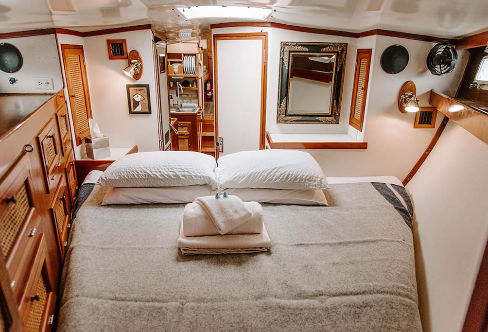 Forward cabin & main, private sleeping quarters.  This v-berth bed has a custom mattress that we find very comfortable!