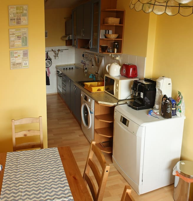 Kitchen with dish washer, coffee machine, fridge and washing machine. All at your disposal.