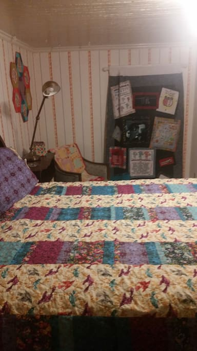 Spacious Room surrounded by custom made quilts!