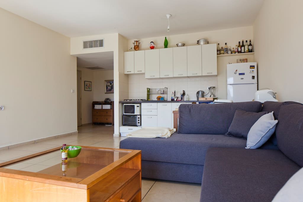 Large living room and comfortable well equipped kitchen.