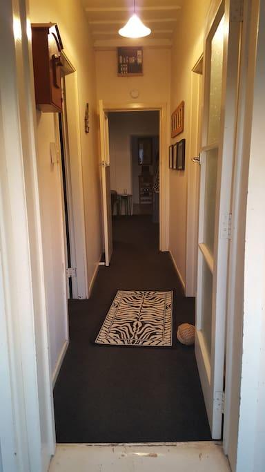 Walk in the front door..guest bedroom is on the right