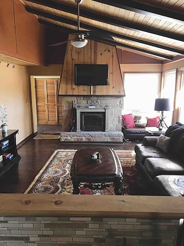 Living room with brand new HD Television and fireplace.