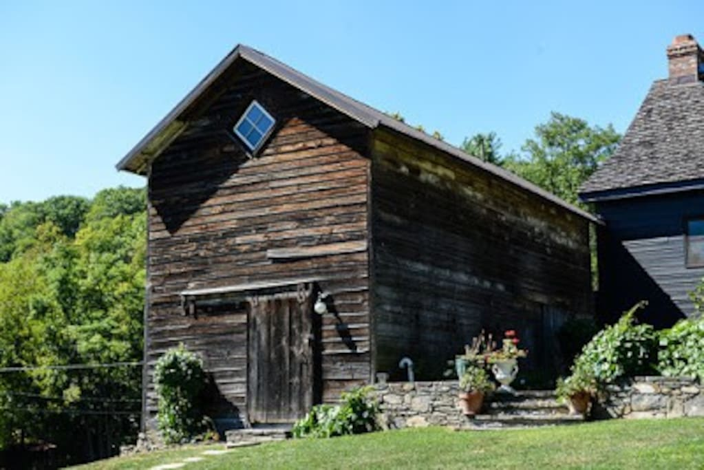 Two story original rustic cabin maintains privacy for guests
