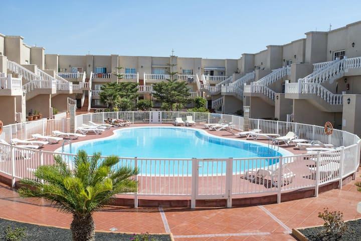 Appartamento con piscina Las Arenas 4P Caleta de Fuste di Lightbooking