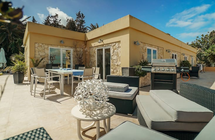 Large terrace and entertaining area near the swimming pool