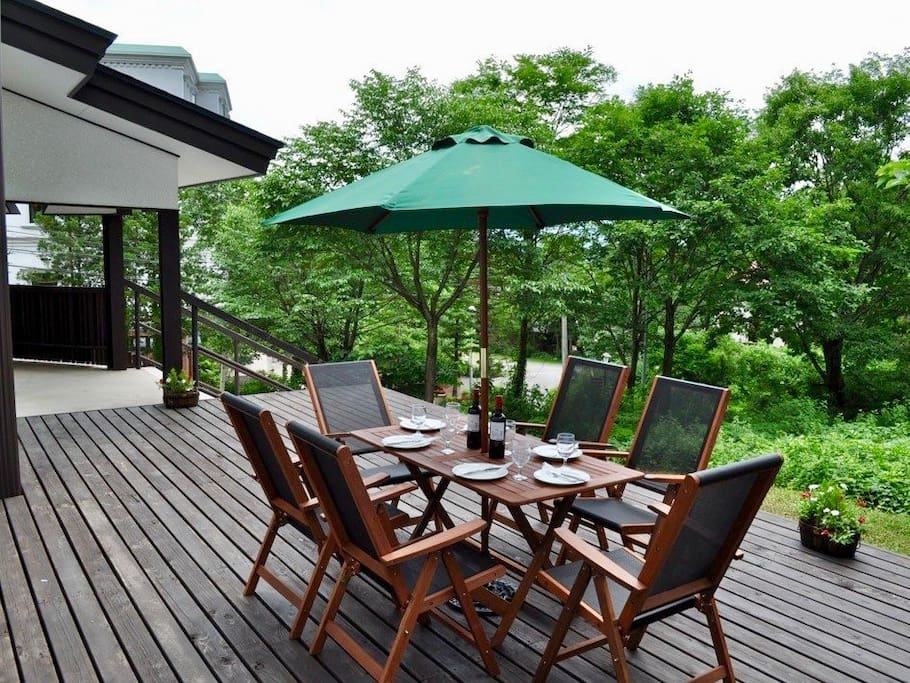 Large sunny deck with beautiful vistas and lots of outdoor furniture to be able to host a awesome BBQ for you and your friends.