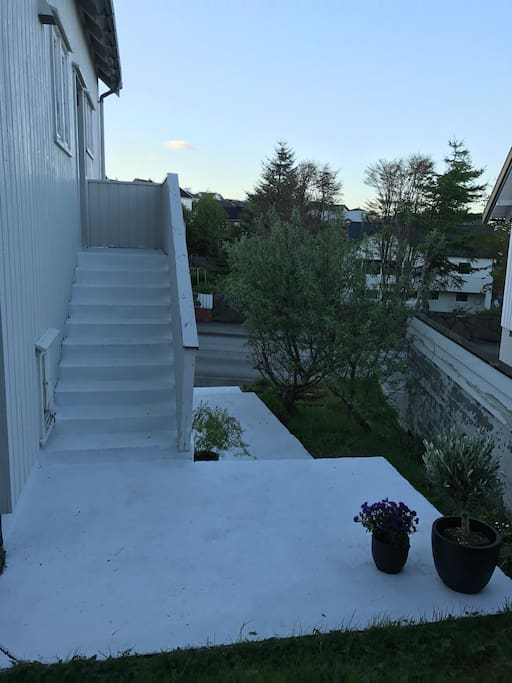 Outside the house, stairs to the main door