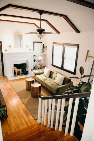 View of living room from hallway.  Non-working fireplace, purely aesthetic.  Sofa-bed, Full-size, sleeps 1 adult or 2 children. For added comfort, we also have a mattress pad, hotel style bed linens.