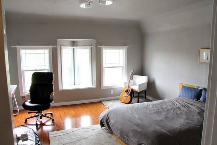 Large room in transit-friendly updated home