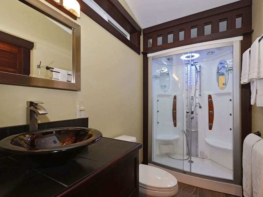 Garden Suite bathroom includes a 2-person steam shower with 12 Jacuzzi jets