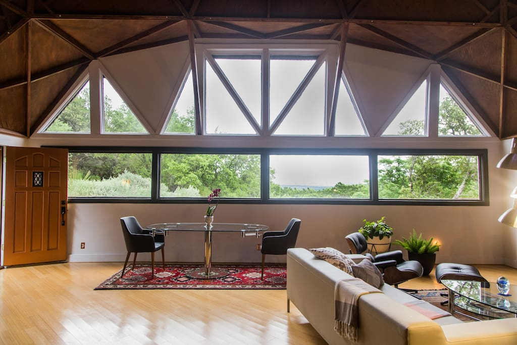 8 person glass dining table. Additional chairs provided. The glass wall faces east with a view of downtown Austin
