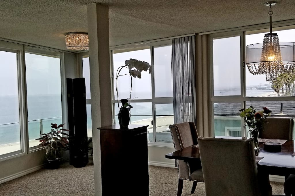 You have an ocean front view from the dining area, which is adorned with chandeliers.