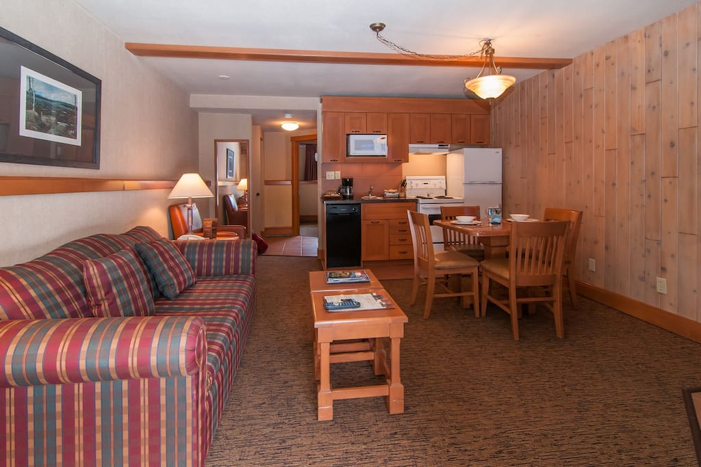 Our cozy mountain condo features warm and inviting living spaces.