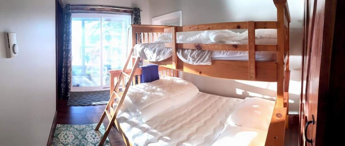 2nd bedroom has a sliding patio door that leads out to the new deck, direct access to the lake